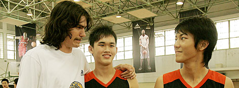 Adam Morrison  (left) greets young  basketball players after a training session of the adidas superstar camp May 22 in Shanghai. Along with Trail Blazers swingman Martell Webster, Morrison gave lessons in the game to 61 young ballers from around Asia.