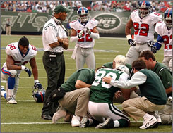 Medical officials tend to Jets receiver Wayne Chrebet during a 2003 game against the Giants. Chrebet went on injured reserve after the game with post-concussion syndrome.
