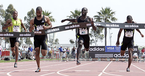 Tyson Gay, second from left, crosses the finish line to win the men's 100-meter dash at the Adidas Track Classic this past May. Gay clocked the world's fastest 100 and 200 times in 2006.