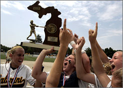 Allen Park Cabrini celebrates its first place trophy after winning the 2007 Michigan High School Athletic Association Division 4 Softball Finals, 10-0.