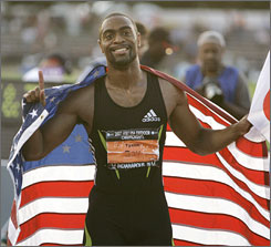 Tyson Gay celebrates after winning the 100-meter dash at the Track and Field Championships. Gay's time of 9.84 seconds is the fastest ever run by an American in the United States.