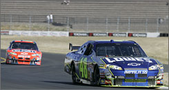 Jimmie Johnson leads teammate Jeff Gordon during morning practice on Saturday.