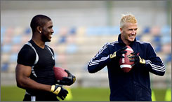 "Reggie Bush, left, and David Beckham match skills in Adidas' ""Futbol meets Football"" marketing campaign, which is set to launch this week."