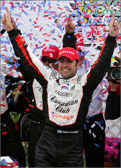 Dario Franchitti celebrates after winning the Iowa Corn Indy 250 on Sunday. Franchitti, who also won the Indy 500, held off a late charge from Marco Andretti to win the race.