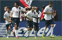 Landon Donovan (10, center) receives congratulations from his Team USA teammates, including DaMarcus Beasley (7) and Brian Ching (11) after scoring the game-tying goal against Mexico in Sunday's Gold Cup final.