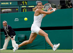 Amelie Mauresmo prepares to hit a backhand return to Jamea Jackson in her first match in defense of her Wimbledon crown.