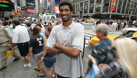 The Gators' Corey Brewer poses in New York's Times Square earlier this month. Brewer opted to return to Florida after winning the NCAA championship in 2006 despite his family's financial situation. The native Tennessean is perhaps the most talented of the Florida prospects.