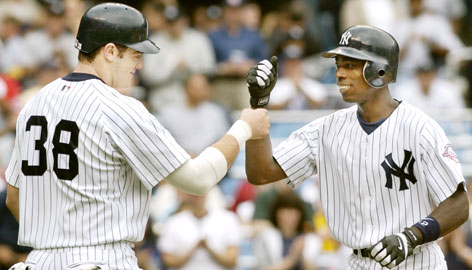 Drew Henson greets then-Yankees teammate Alfonso Soriano at home during a Sept. 2003 game against the Orioles in New York. Henson was a star quarterback at Michigan, but left early to sign a six-year, $17 million contract with the Yankees. Henson got just nine-major league at-bats before pursuing a career in football.