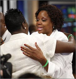 Zoe Oden, right, hugs a family member after her son, Greg, was selected first-overall by the Portland Trail Blazers.