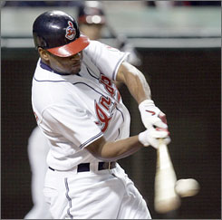 Cleveland's Ben Francisco connects for the game-ending homer that carried the Indians past the Tampa Bay Devil Rays and into first place in the AL Central.