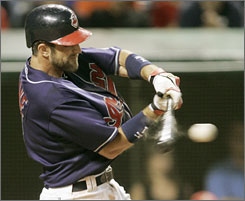Casey Blake smacks a two-RBI single as part of Cleveland's 8-6 victory over Tampa Bay. Indians starter C.C. Sabathia became baseball's first 12-game winner.