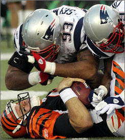 You're looking at a $40 million pileup. On top: New England defensive lineman Richard Seymour (93), the highest-paid player in the NFL last year in total salary at $24,691,160, despite a base salary of just $585,000. On the bottom: Cincinnati quarterback Carson Palmer, seventh-highest at $15,750,000.