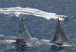 America's Cup defender Alinghi, right, and challenger Emirates Team New Zealand get ready to start Race 7 of the America's Cup Tuesday. In an exciting race with a dramatic finish, Alinghi held off Team New Zealand and retained the America's Cup.