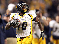 West Virginia running back Steve Slaton scores on a long first half catch in this Nov. 2006 game at Pittsburgh. Slaton finished fourth in Heisman voting last season and is expected to be a front-runner for this year's award.