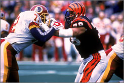 Anthony Munoz, right, shown during a 1988 game against Washington, was an All-Pro for 11 consecutive years.