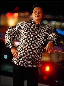 World Series of Poker player Johnny Chan poses outside of a casino in Las Vegas. Chan likes bright colors and usually wears Versace silk shirts with a pair of Versace slacks.