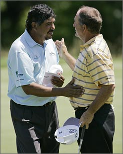 Eduardo Romero, left, talks with Jay Haas after finishing up the ninth hole at the U.S. Senior Open.