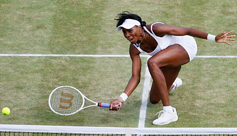 Venus Williams plays a shot at the net during her straight-set victory over Ana Ivanovic in the semifinals.
