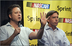 NASCAR CEO Brian France, left, with chief marketing officer Tim Kelly, announces the change of the top series to Sprint Cup.