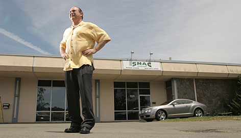 """Victor Conte stands in front of the building where BALCO, the company he founded, used to be located in Burlingame, Calif. The building now houses Conte's new company, Scientific Nutrition for Advanced Conditioning. Conte says the location is where he became the """"Saddam Hussein of sports."""""""