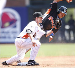 The USA's Chris Coghlan takes out the World team's Chin-Lung Hu at second base during the third inning. Hu was named the All-Star Futures game's MVP as the international squad prevailed 7-2.