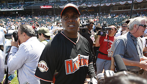With a sea of media swirling, Barry Bonds is on the lookout during Monday's batting practice for the All-Star Game.