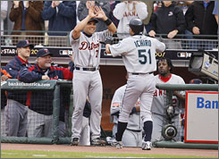 After rounding the bases with the All-Star Game's first inside-the-park home run, Ichiro Suzuki receives congratulations from Ivan Rodriguez just before entering a happy American League dugout.