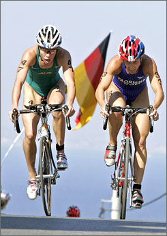 America's Sheila Taormina, right, and Australia's Loretta Harrop strain up a hill during the cycling leg of the women's triathlon during the 2004 Summer Olympics in Athens. Taormina will attempt to qualify for the 2008 Beijing Olympics in modern pentathlon at the Pan Am Games, and if she succeeds she will become the first woman to compete at the Olympics in three different sports.