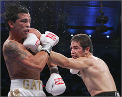 Alfonso Gomez lands a punch on Arturo Gatti during the 5th round of their welterweight fight. Gatti, a two-time former world champion, announced his retirement after a seventh-round TKO by Gomez.