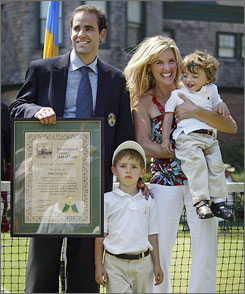 Pete Sampras is photographed with his wife, Bridgette, and their two sons Ryan, 2, and Christian, 4, after being inducted into the International Tennis Hall of Fame.