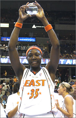 Cheryl Ford of the Detroit Shock raises her trophy as MVP of the WNBA All-Star Game. Ford had 16 points and 13 rebounds as the East prevailed over the West 103-99.