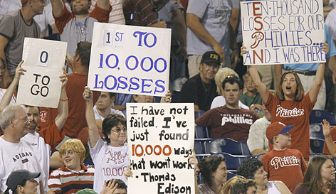 The fans of Philadelphia tell the story of their team becoming the first major pro club to reach 10,000 losses. The historic moment came Sunday when the Phils fell to the St. Louis Cardinals 10-2.