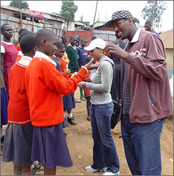 "The Kings' Ron Artest greets children in Kenya during his aid trip with a group of NBA players. Artest and the group spent the past week in Nairobi participating in ""Feeding One Million,"" a campaign by the NBA players' union to distribute food to impoverished residents."