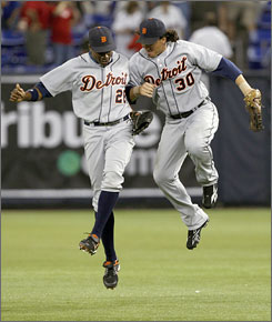 The Tigers jumped for joy after beating Johan Santana and the Twins 3-2 on Wednesday. Curtis Granderson, left, and Magglio Ordonez shared the good times at game's end. Ordonez had all three RBI as Detroit took an eight-game lead on its division rival in the AL Central.