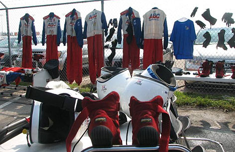 Crewmembers' uniforms and equipment hang on the fence to dry after heavy rain forced the Firestone Indy 200 at Nashville to be postponed a day.