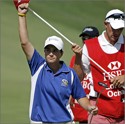 Meaghan Francella pumps her fist after finishing off her second-round upset of top-ranked Lorena Ochoa at the HSBC Women's World Match Play Championship