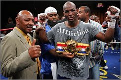 Bernard Hopkins, right, poses with former boxer Marvin Hagler after winning a unanimous decision over Ronald 'Winky' Wright. The 42-year old Hopkins gave Wright his first loss since 1999.