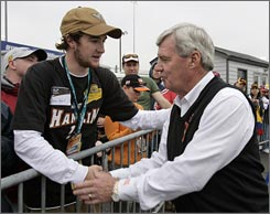 Virginia Tech football coach Frank Beamer shakes hands with student Adam Warf before a NASCAR memorial for the school's April 16 shooting victims.