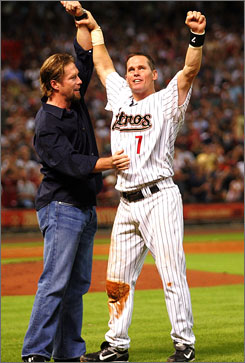 Craig Biggio, right, celebrates with longtime Houston Astros teammate Jeff Bagwell after collecting his 3,000th career hit on June 28 against the Colorado Rockies. Biggio announced Monday that he will retire after the season, his 20th in the majors.