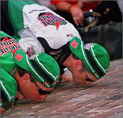 Bobby Labonte, right, kissed the bricks after winning the Brickyard 400 on his way to the season points title in 2000.