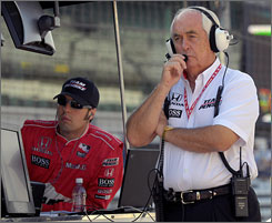 Roger Penske, here watching practice for the Indy 500 in May with driver Sam Hornish Jr., left, says his organization is capable of fielding a Nextel Cup team for Hornish, but no decision has been made.