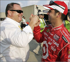 Reed Sorenson and team owner Chip Ganassi celebrate the driver's first Nextel Cup pole.