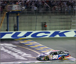 Stephen Leicht flashes under the checkered flag June 16 at Kentucky Speedway to register his first Busch Series triumph. Busch regulars such as Leicht, however, have mostly encountered rough road this season.
