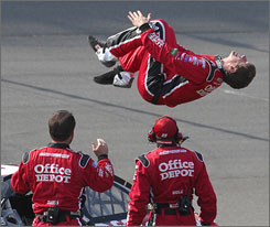 Carl Edwards does his usual backflip after his victory at Michigan in June. The victory ended a 52-race winless drought for the Roush Fenway driver.