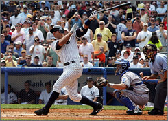 New York Yankees third baseman Alex Rodriguez follows the flight of the ball as it heads for the left-field stands. The ball stayed fair and reached the stands, giving Rodriguez his 500th home run. He becomes the youngest player to reach 500 HRs.
