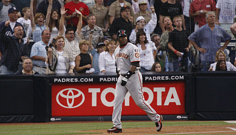 San Francisco's Barry Bonds watches his 755th home run fly into the Petco Park seats, leaving him tied with Hank Aaron for No. 1 on baseball's all-time home run list.