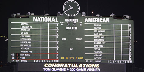 Wrigley Field's scoreboard lets everyone know that visiting pitching Tom Glavine reached a big-league milestone when the Mets beat the Cubs 8-3 on Sunday night.