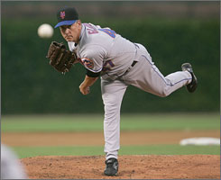 Tom Glavine works to the Cubs en route to his 300th victory. The Mets lefthander is the 23rd major leaguer to reach the coveted plateau.