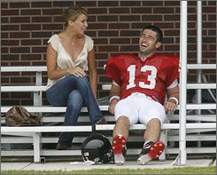 Joey Harrington, with wife Emily after a Falcons workout, has taken the reins of the Atlanta offense. The former Lions and Dolphins signal caller has a chance to rejuvenate his career under new coach Bobby Petrino.