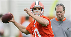 Brady Quinn throws a pass under the eye of Browns quarterback coach Rip Scherer during minicamp in May.